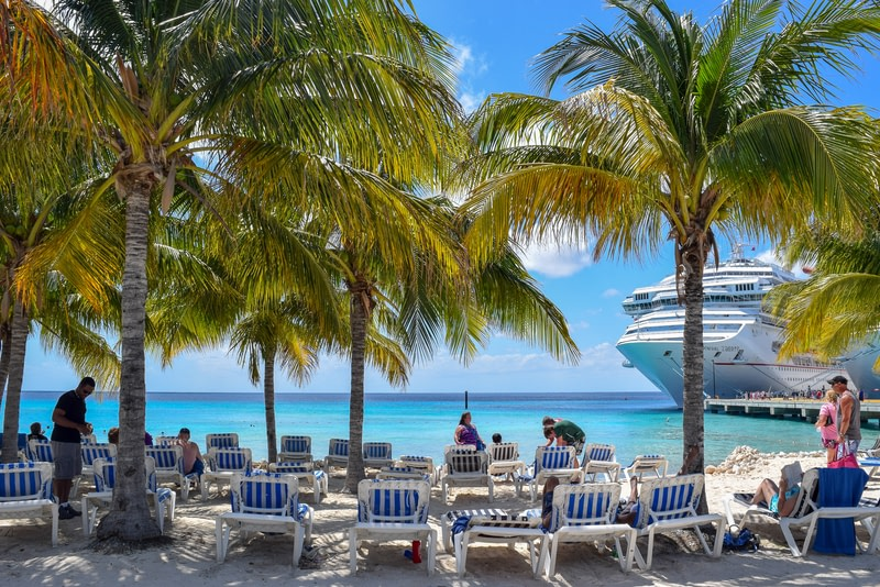 Cruise Ship passengers spend a sunny day in Beach on the less visited island.