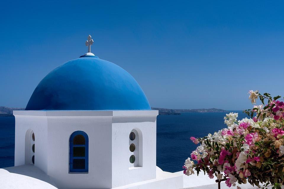 Traditional Greek orthodox blue dome church in Santorini