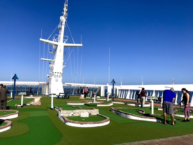 Top deck of cruise ship with golf course.