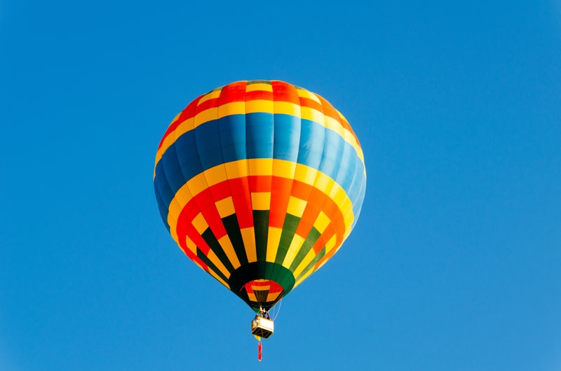 drifting in the sky on a hot air balloon